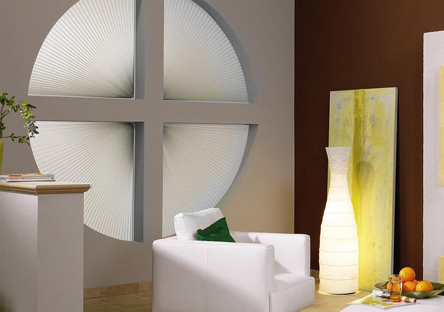 A pleated blind is the solution for a round window.
